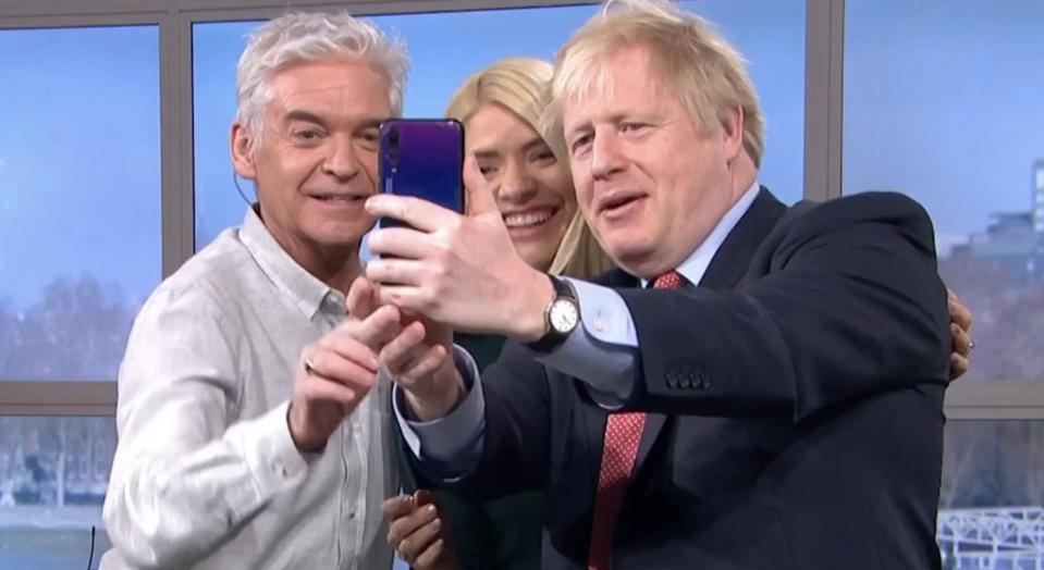 Boris Johnson takes a selfie on a U.K. television show using a Huawei smartphone, causing a media frenzy.