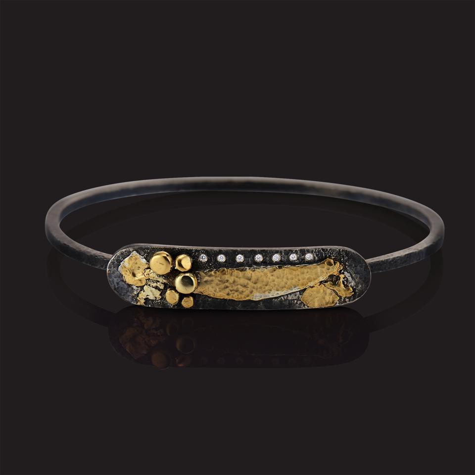 Diamond-studded 22-karat gold and sterling silver bracelet by Deborah Meyers Experience