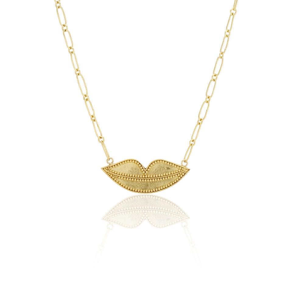 22-karat gold kissing lips necklace by Deborah Meyers Experience
