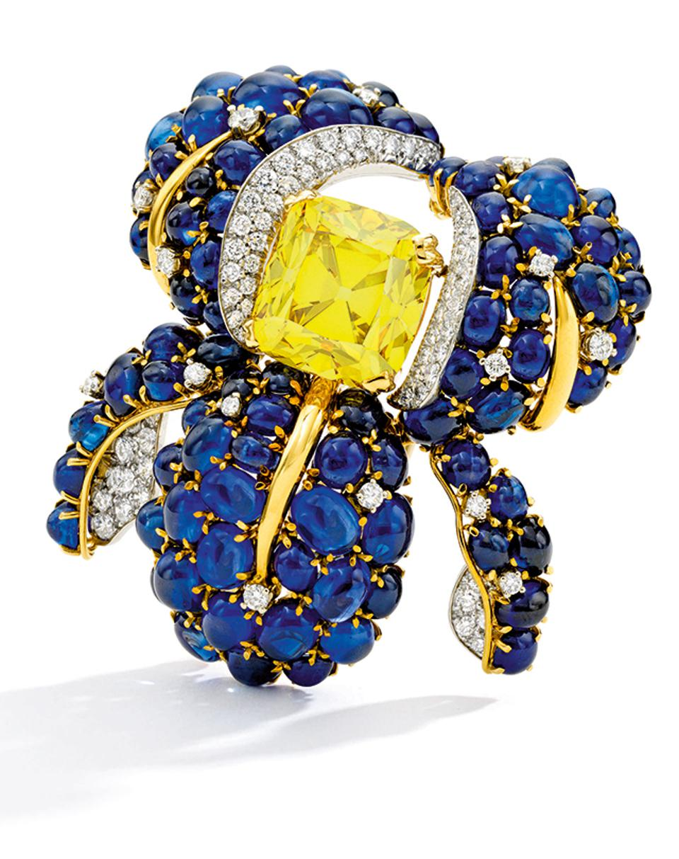 Yellow diamond, diamond and sapphire orchid brooch by Verdura, to be auctioned by Sotheby's