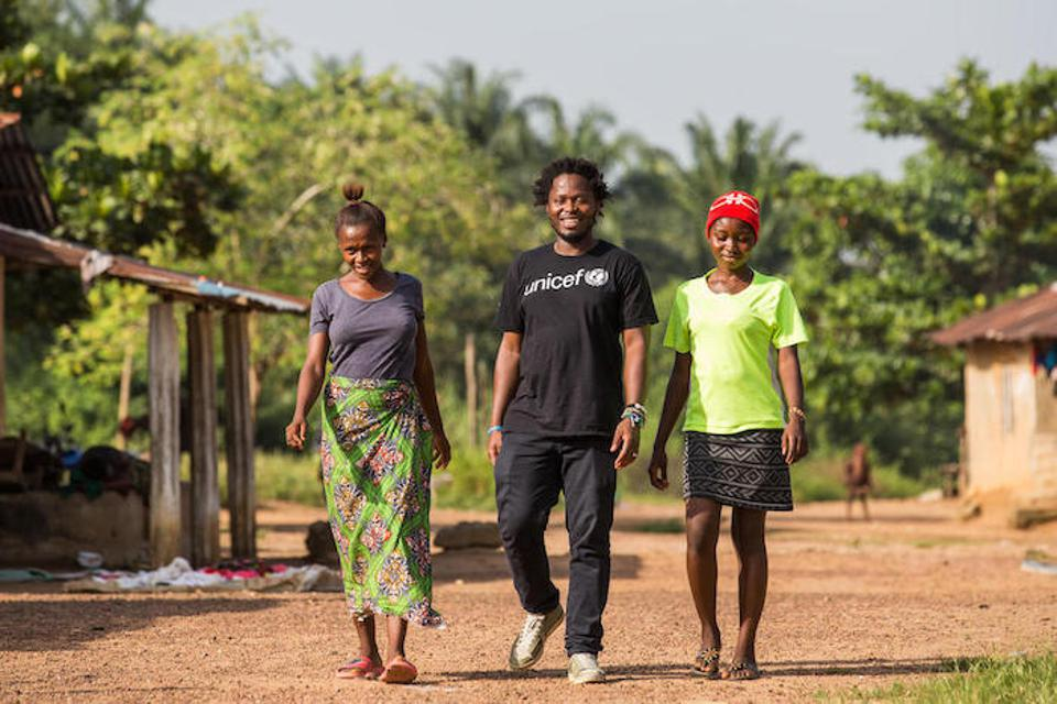 In Sierra Leone's Bombali District, former child soldier and UNICEF Goodwill Advocate for Children Affected by War Ishmael Beah met with orphaned cousins Isatu, 17 (left) and Fatmata, 15, who are receiving support from UNICEF and partners.