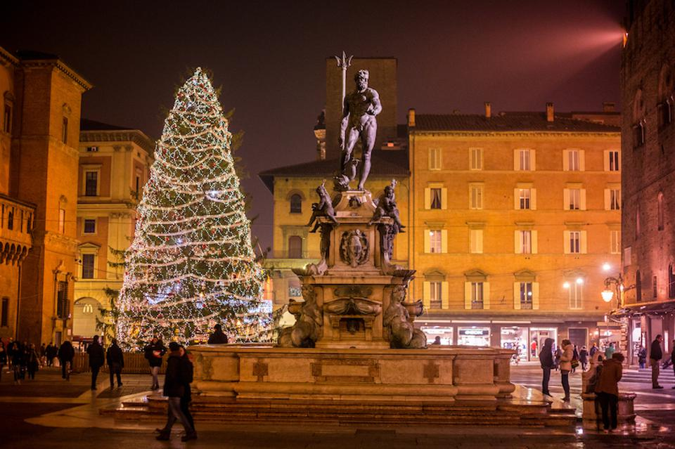 Christmas Tree beside the Fountain of Neptune on Piazza del Nettuno, next to Piazza Maggiore