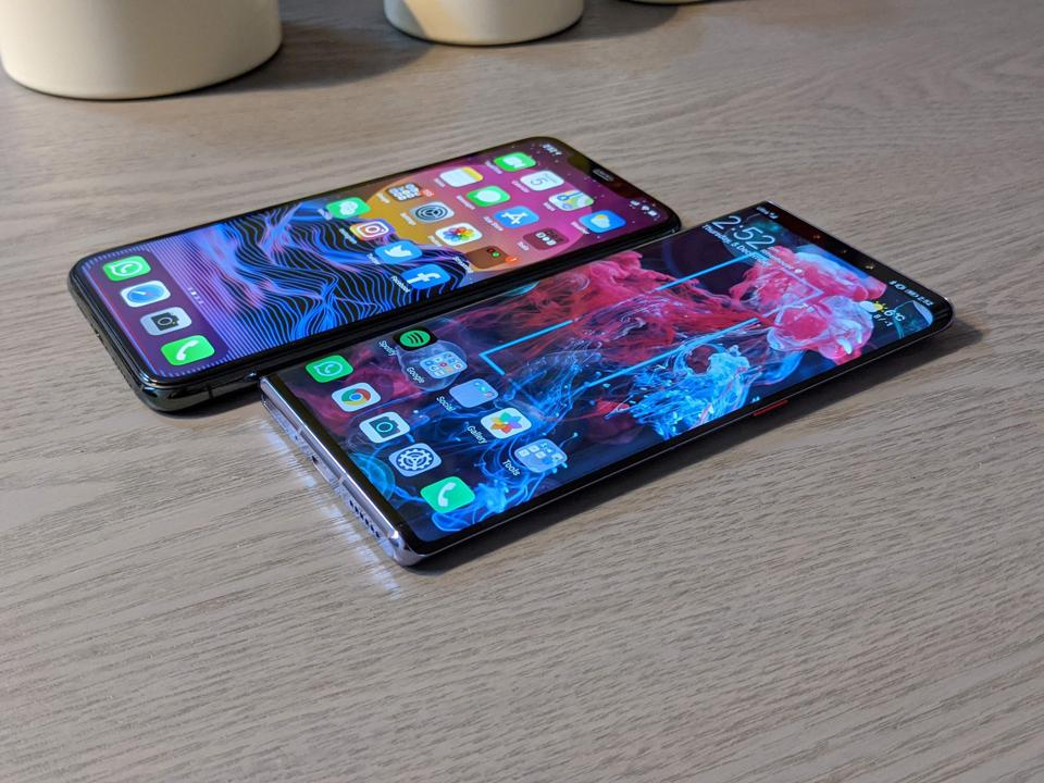 The iPhone 11 Pro Max and the Huawei Mate 30 Pro.