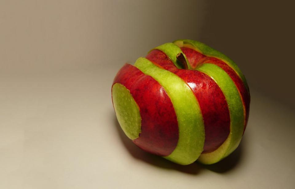 A green and red apple