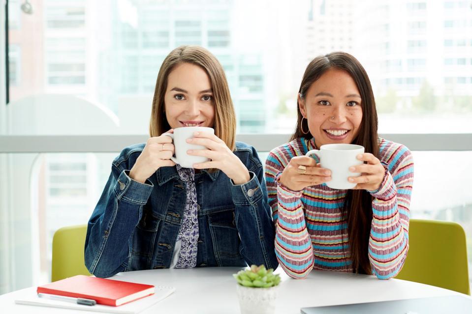 women holding coffee