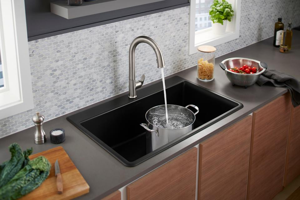 Hands-free kitchen faucet with voice control