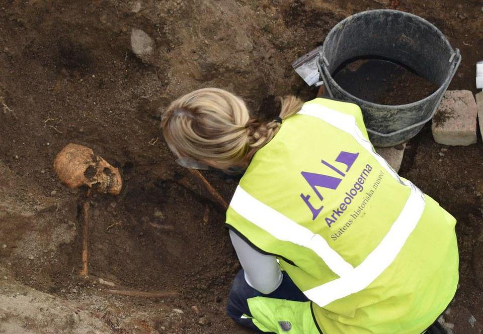 An archaeologist at the Viking grave site in Sweden