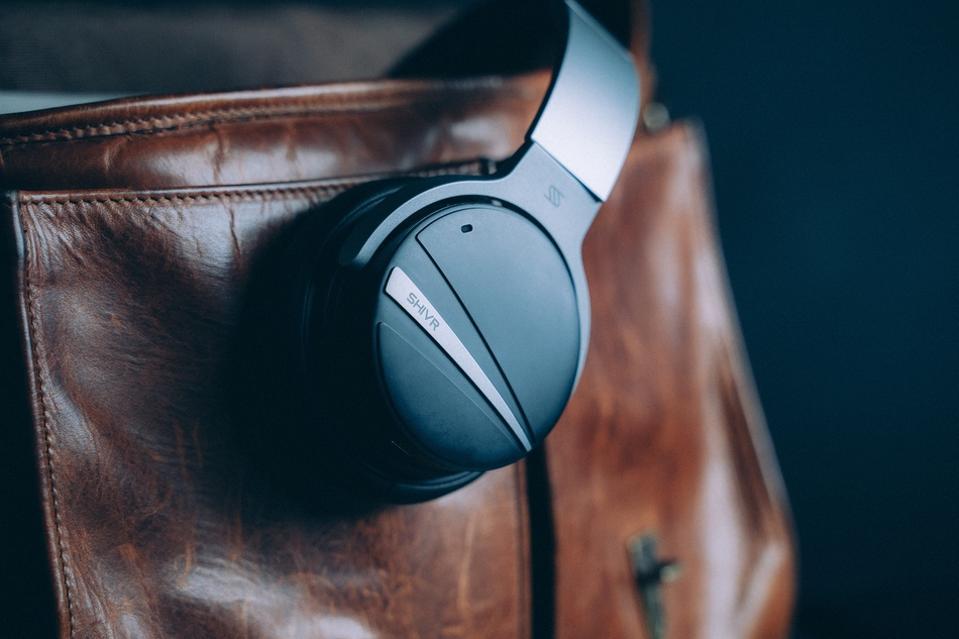 SHIVR NC18 headphones on a leather satchel