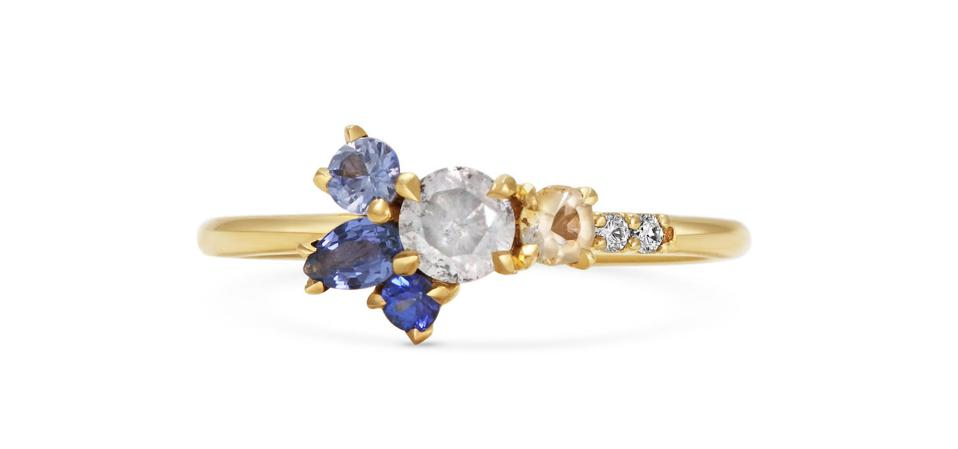 18ct gold engagement ring by Michelle Oh, with blue and yellow sapphires, and white and grey diamonds, price on application.