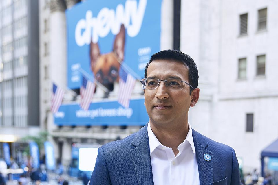 Sumit Singh, CEO of e-commerce pet supplies retailer Chewy, in front of the New York Stock Exchange.