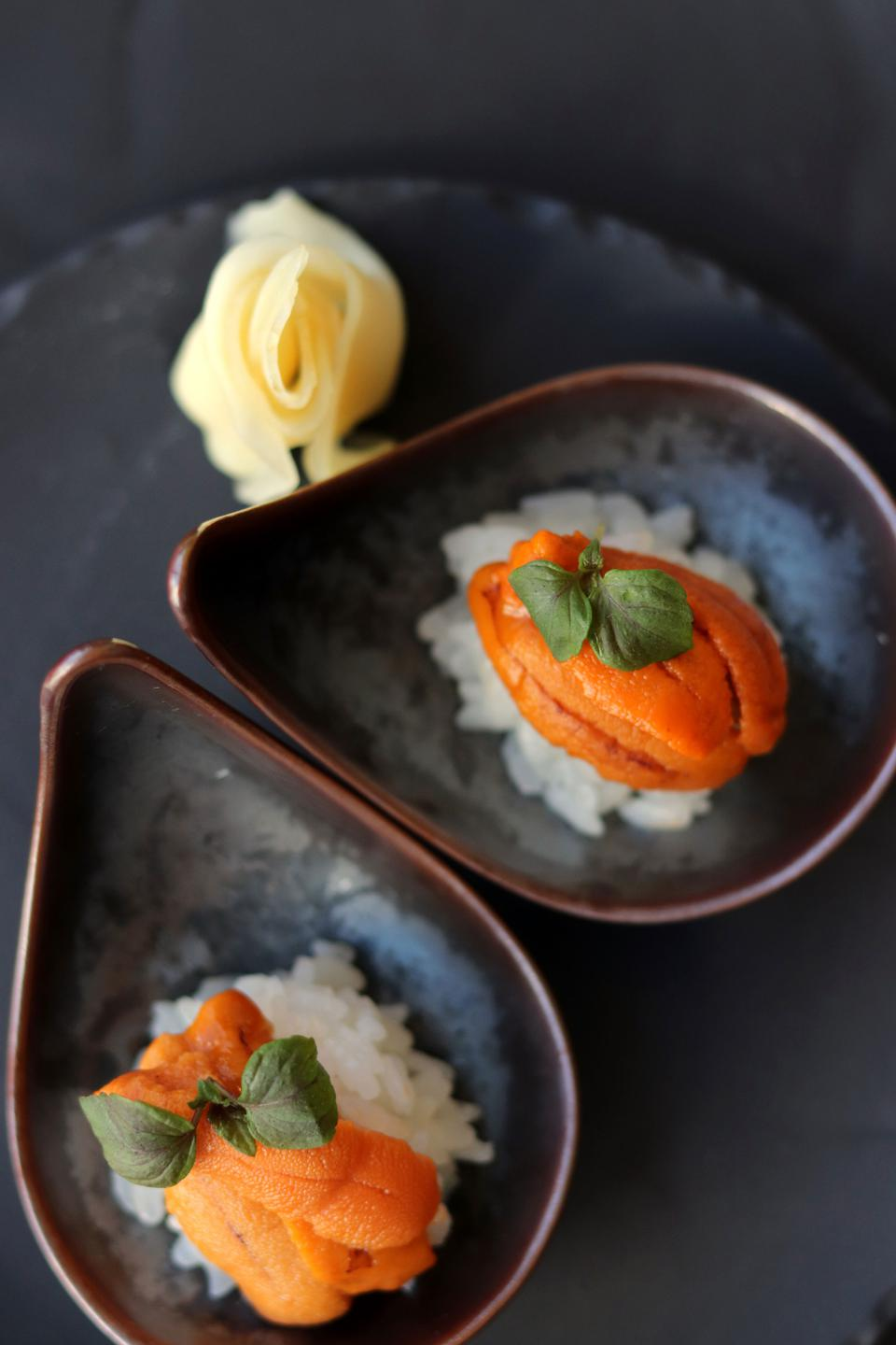 Uni roe served atop rice in a simple and delicious dish.