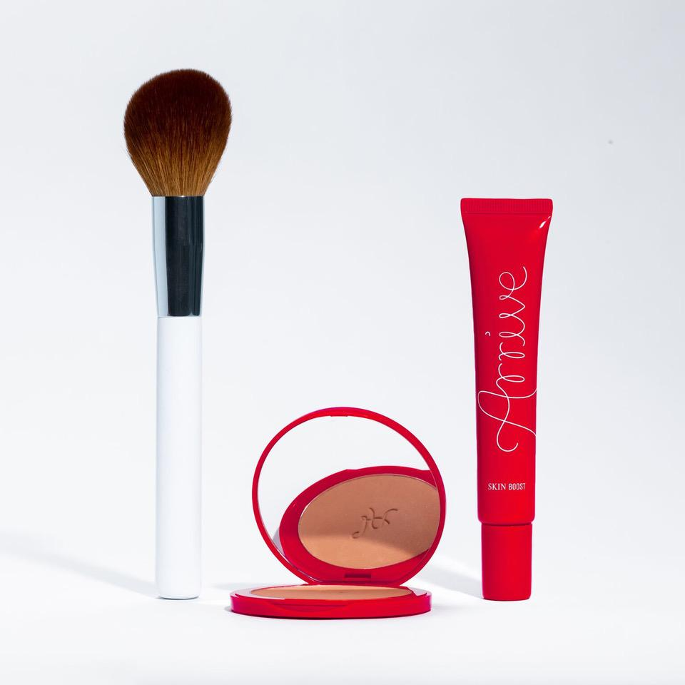 Arrive bronzer, skin boost and powder brush.
