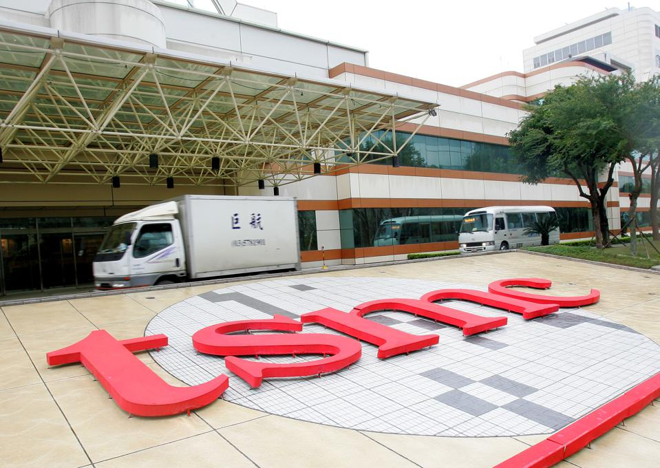 Vehicles pass Taiwan Semiconductor Manufacturing Co. ¡ ¦s factory in Hsinchu, Taiwan, on Wednesday, Jan. 30, 2008. Photographer: Maurice Tsai/Bloomberg News