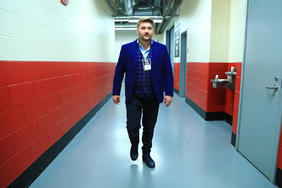 Tim VanNewhouse walking the halls of one of the many arena's he visits on a weekly basis.