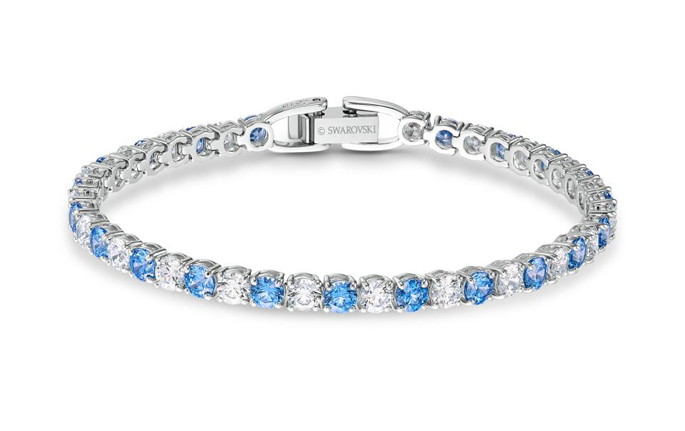 A frosty blue and white crystal tennis bracelet by Swarovski is an affordable luxury.