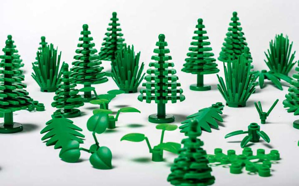 Green plastic LEGO bricks in the shape of trees, leaves and bushes.
