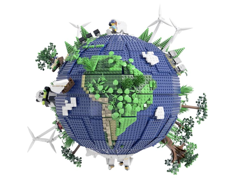 A small Earth model made of LEGO bricks, with trees, plants, windmills, and pandas.