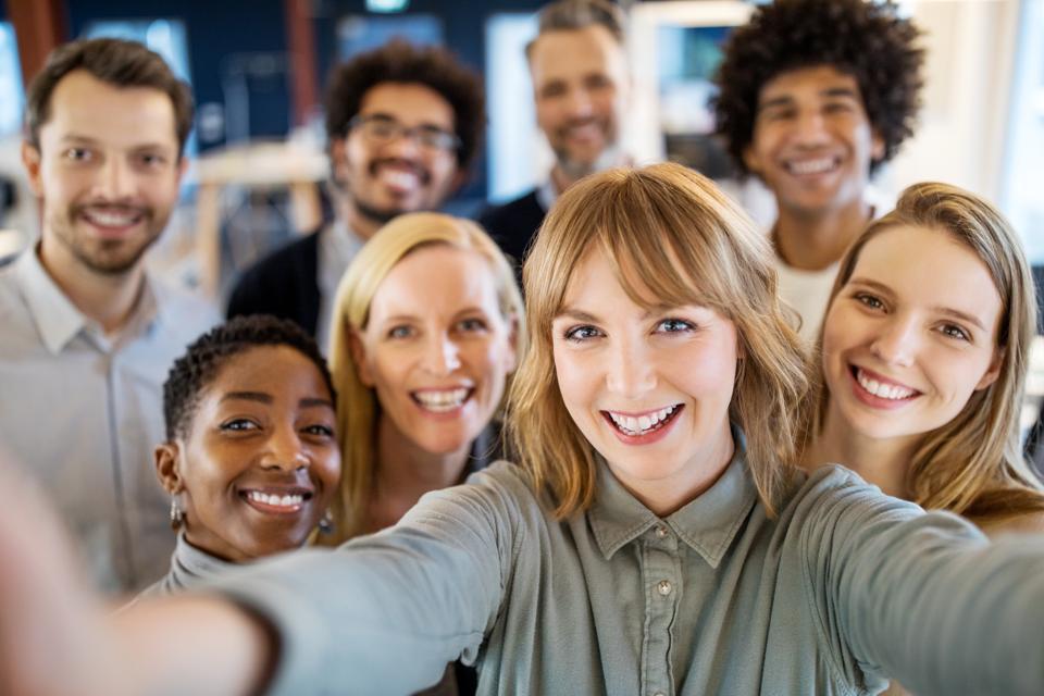 Successful business team taking selfie