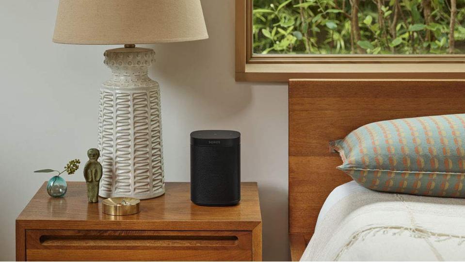 Sonos One SL speaker on a nightstand.
