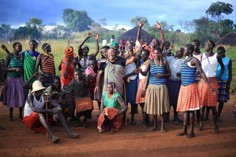A group of young African women celebrating in rural Uganda.