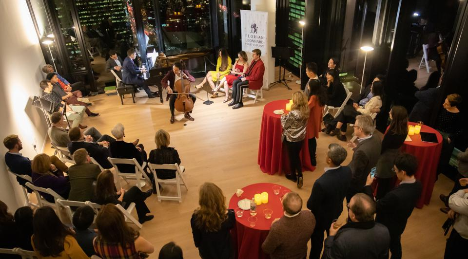 Cellist Yves Dharamraj performs for members and guests at an After Arts Revelry.