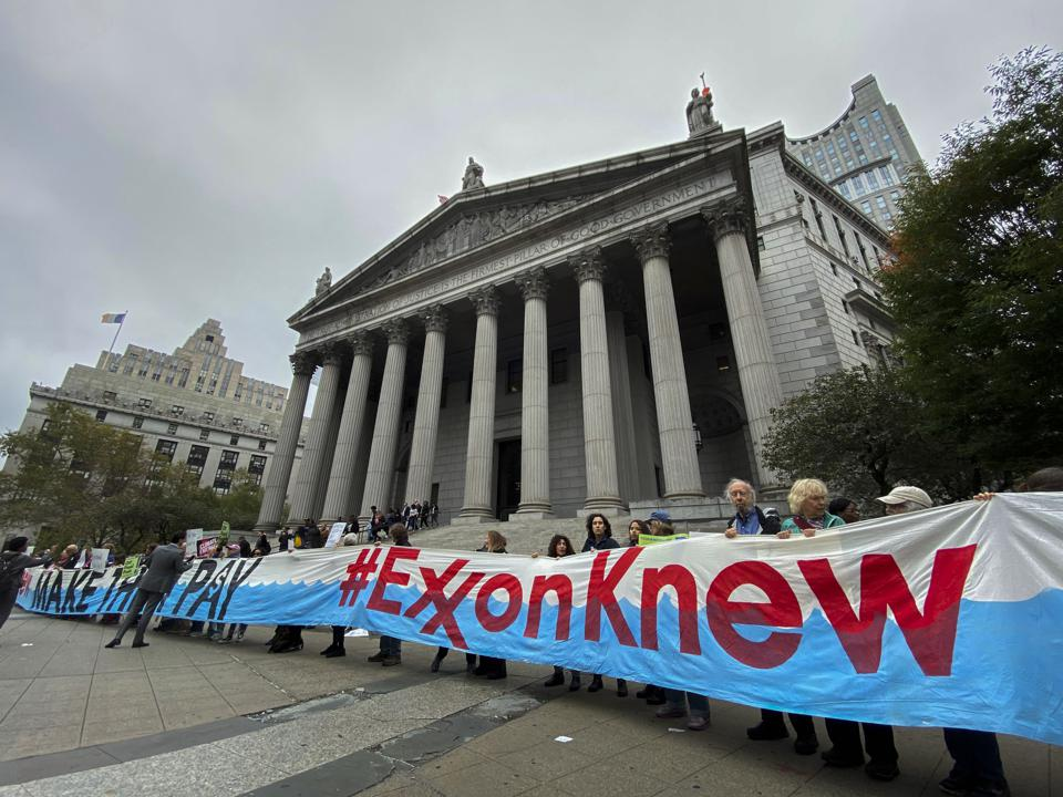 People Protest Outside Supreme Court during Exxon Fraud Trial