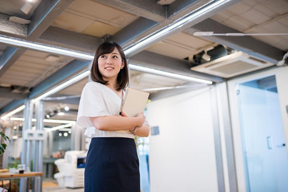 Female employee standing in office