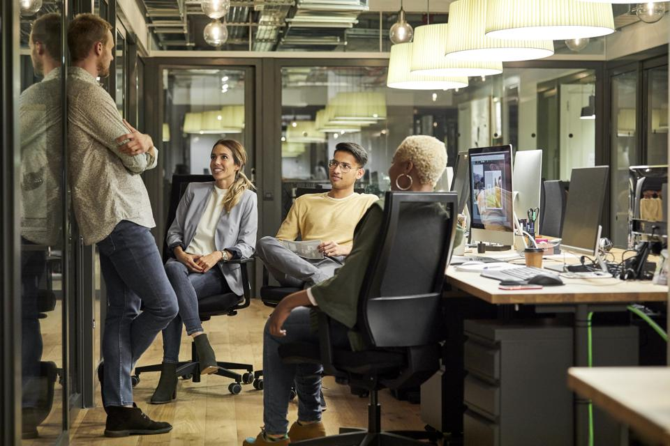 Business people discussing in creative office