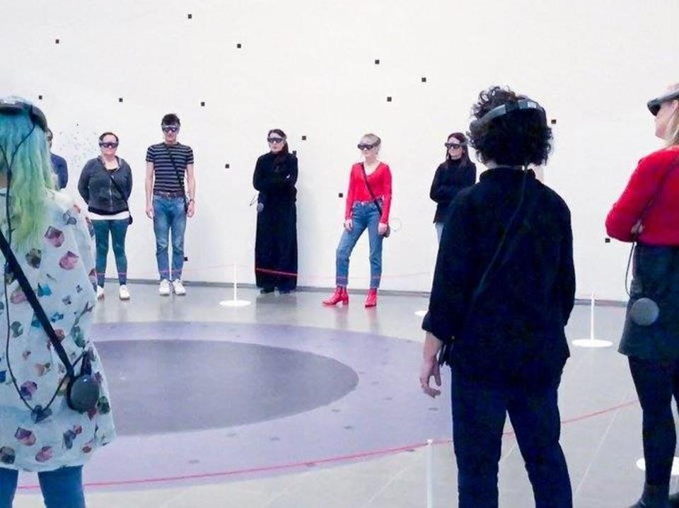 Audiences at the inital showing of Abromovic's video ″The Life″ wore Magic Leap One.