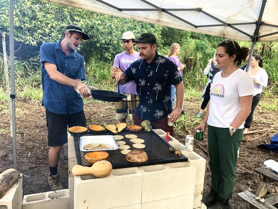 Baby Health in Winter Guests help prepare the feast at De La Mesa farm to table dinner in Waimanalo, Hawaii