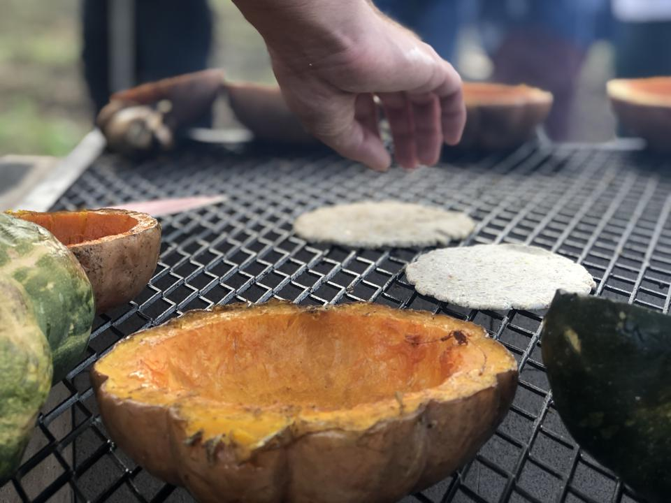 Baby Health in Winter Grilling fresh tortillas and squash at De La Mesa farm to table dinner in Waimanalo, Hawaii