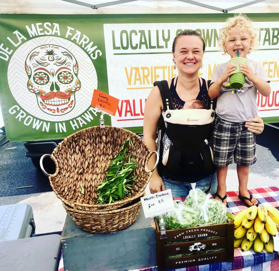 Baby Health in Winter Natalie Mesa and her son manning their booth at the Kakaʻako Farmers Market