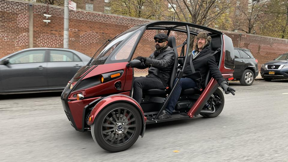 Arcimoto President Mark Frohnmayer enjoying the ride in his ″Fun Utility Vehicle″
