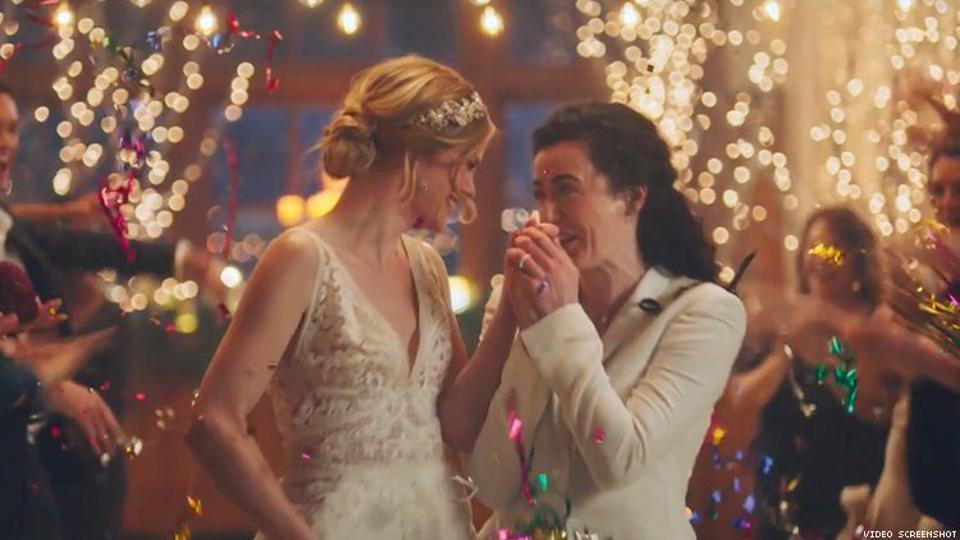 Two of the four ads from wedding planner Zola featuring a man and a woman were not pulled by Hallmark Channel.