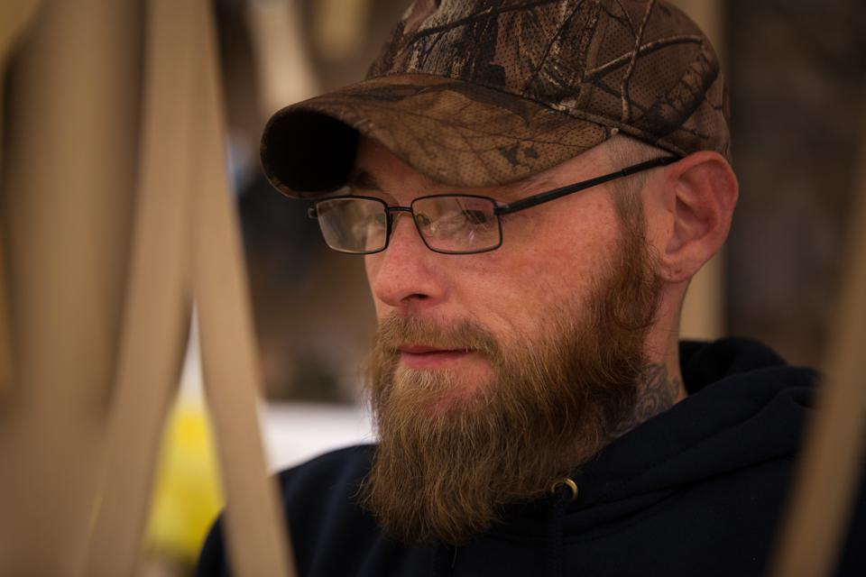 Jeremy Haney, a recovery drug addict makes instruments in Eastern Kentucky.