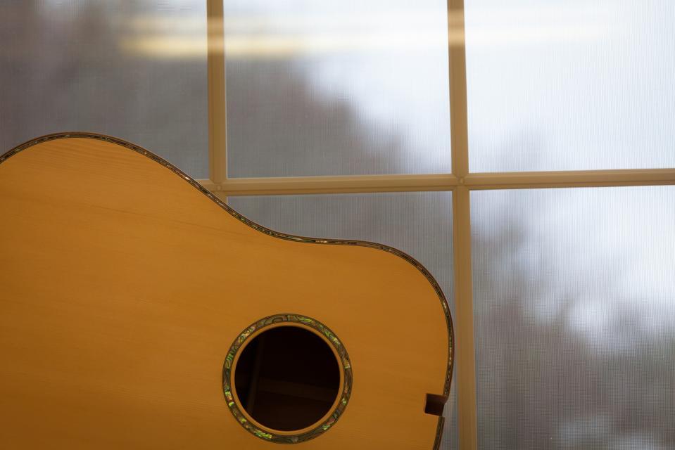 Guitar sits in a window in Appalachia.