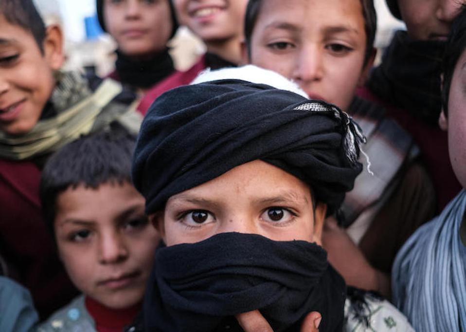 A group of boys stand outside the UNICEF-supported Shaheed Abdul Ahad Khan Karzai Orphanage in Kandahar, Afghanistan on November 22, 2019.