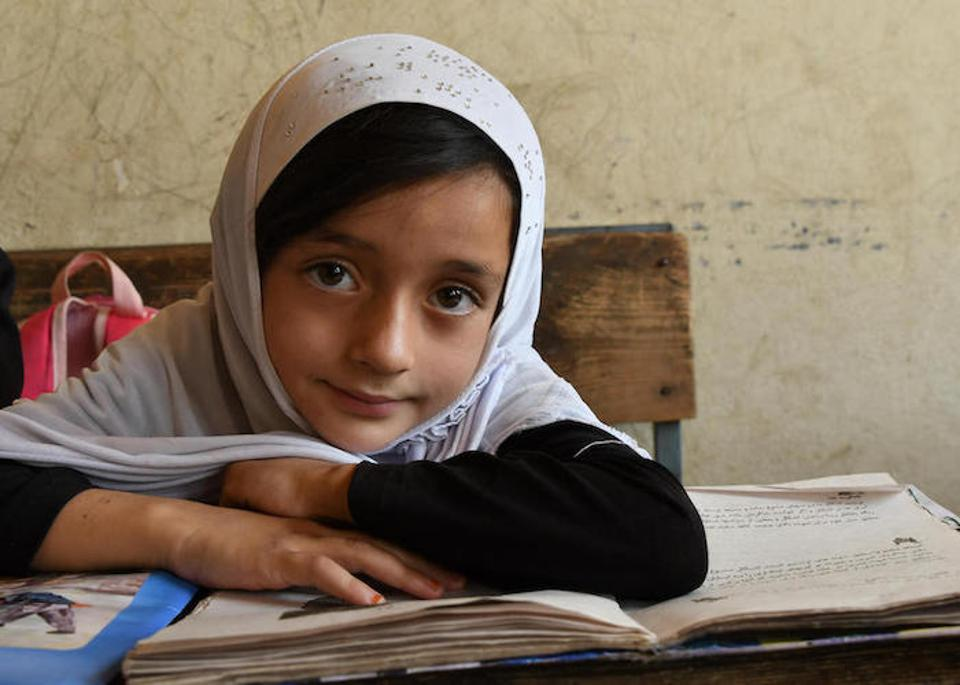 A girl looks up from her studies at the Turgani High School in the city of Faizabad, Badakhshan province, in northeastern Afghanistan, in August 2019.