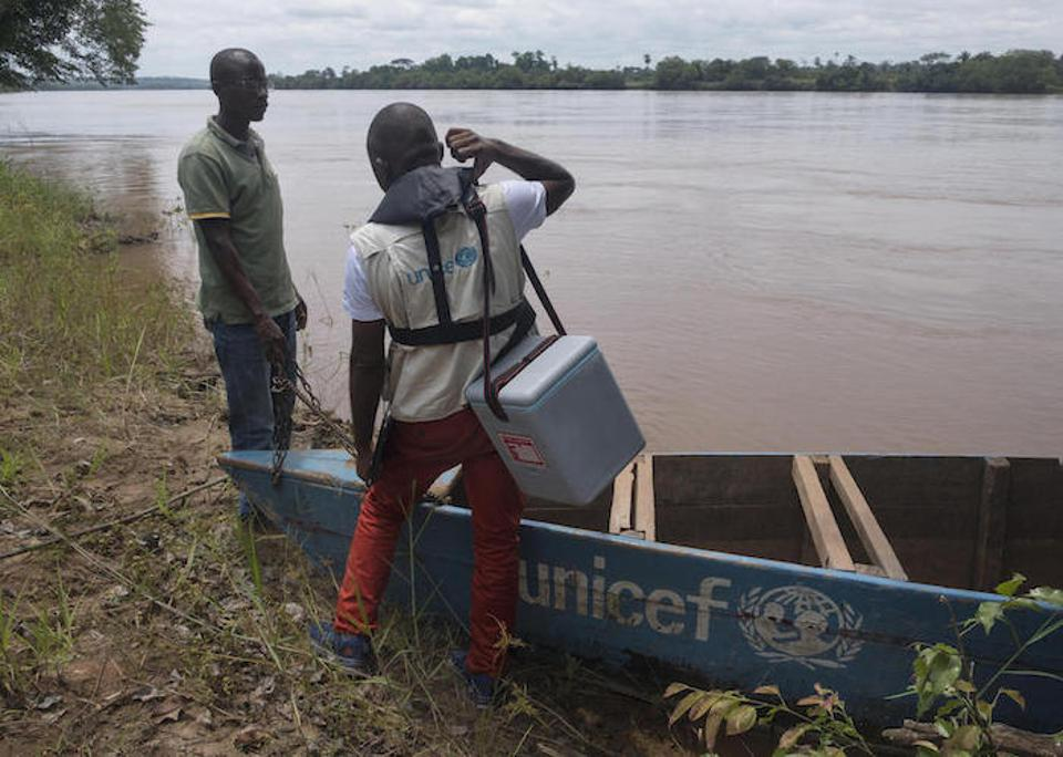 A UNICEF mobile vaccination team travels by boat on the Kasai River to reach remote villages in the Democratic Republic of Congo (DRC).