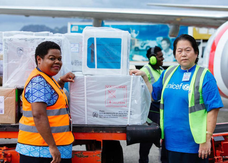 UNICEF staff members unload measles vaccines and related medical supplies at Nadi International Airport in Fiji.