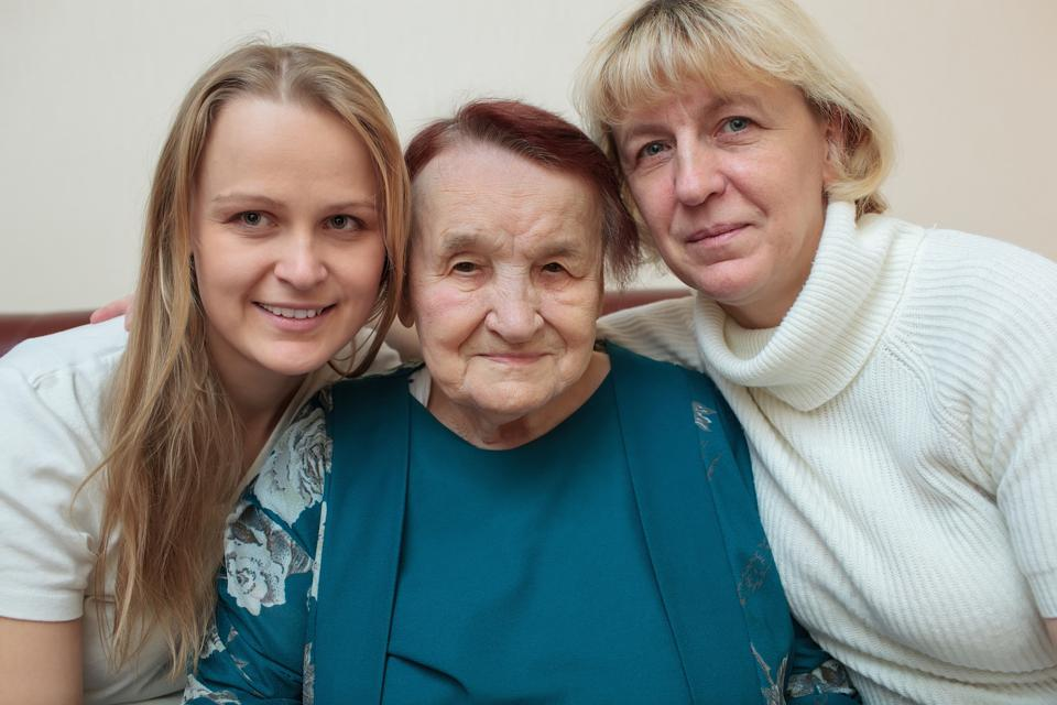Two women with older woman
