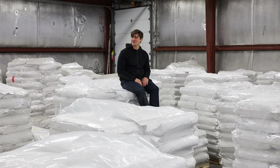 Josh Tetrick among stacks of mung bean protein isolate at JUST's new factory.