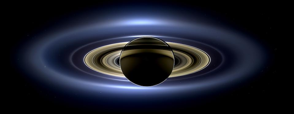 n July 19, 2013, in an event celebrated the world over, NASA's Cassini spacecraft slipped into Saturn's shadow and turned to image the planet, seven of its moons, its inner rings -- and, in the background, our home planet, Earth. With the sun's powerful and potentially damaging rays eclipsed by Saturn itself, Cassini's onboard cameras were able to take advantage of this unique viewing geometry. They acquired a panoramic mosaic of the Saturn system that allows scientists to see details in the rings and throughout the system as they are backlit by the sun. This mosaic is special as it marks the third time our home planet was imaged from the outer solar system; the second time it was imaged by Cassini from Saturn's orbit; and the first time ever that inhabitants of Earth were made aware in advance that their photo would be taken from such a great distance.
