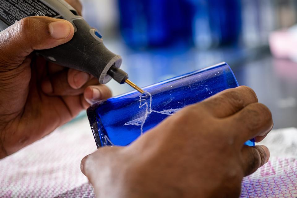 Artist Clovis Oswaldo Patiño Montaño creating art from recyclable glass