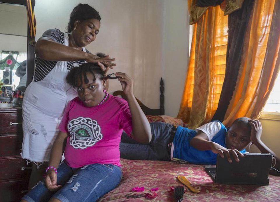Corine Gerald, Sr. and her children Jerrene, 11, and James Jr., 13, live in a rental house in Antigua. The family was displaced from their home in Barbuda by Hurricane Irma in 2017.