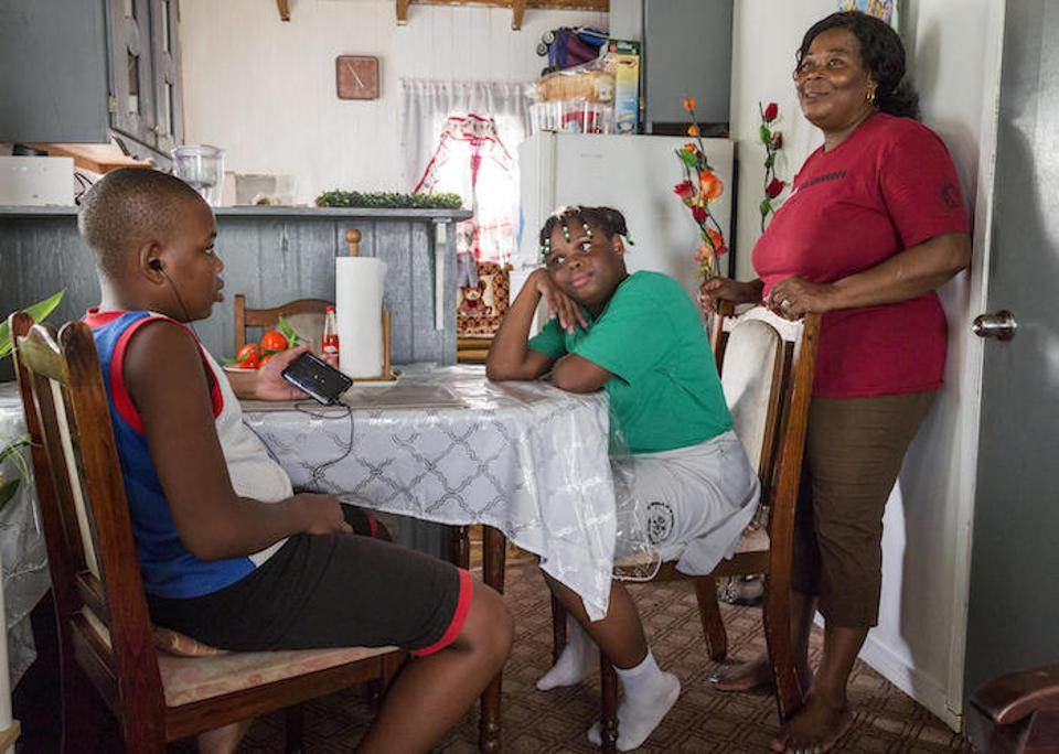 Corine Gerald and her children Jerrene, 11, and James Jr., 13, at their temporary home on Antigua.  The children were traumatized after Hurricane Irma forced them to evacuate. A UNICEF counseling program helped.