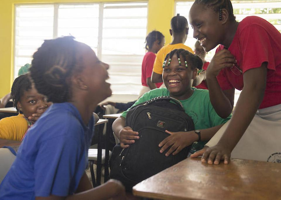 Eleven-year-old Jerrene (center) shares a laugh with fellow students at Princess Margaret Secondary School in St. John's, Antigua. Jerrene and her brother and mother remained in Antigua because there were better education opportunities there.