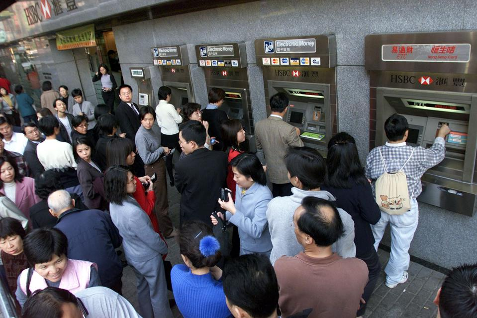 People line up at a branch of Hong Kong Bank's