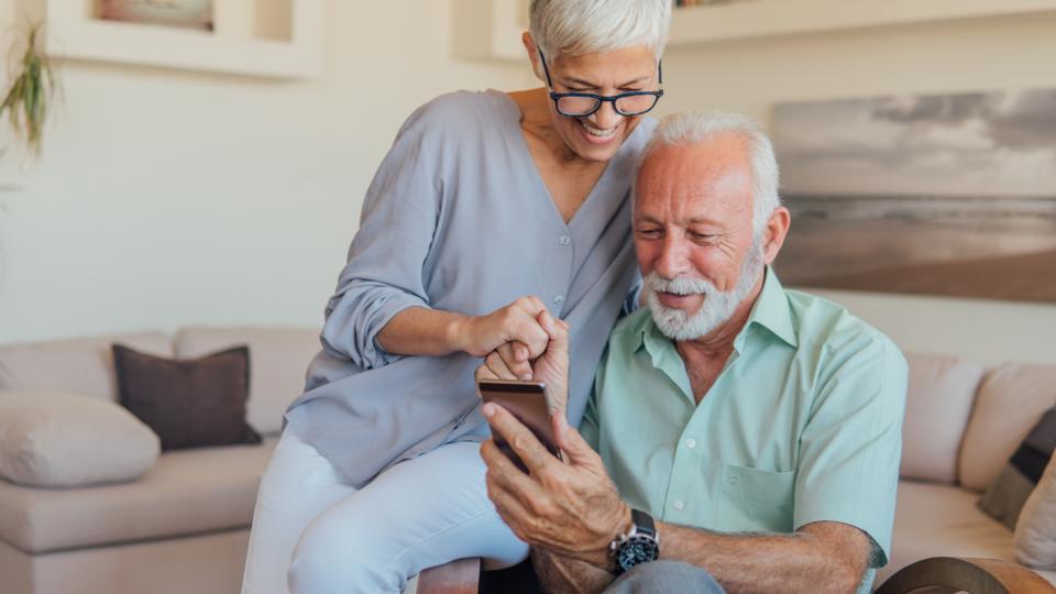 Senior couple using mobile phone