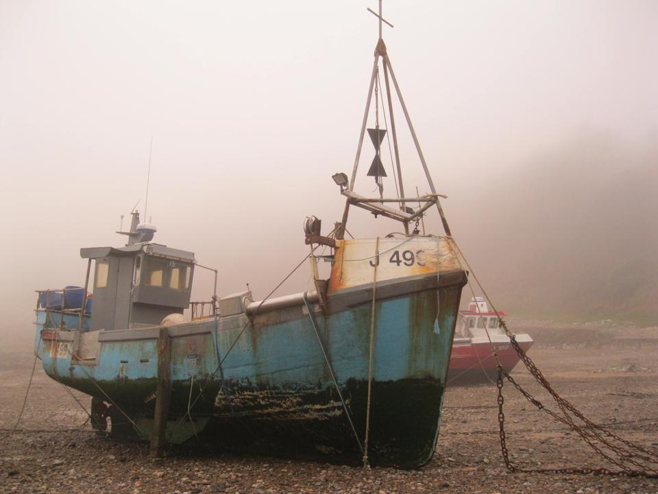 Fishing vessel keeled over at low tide